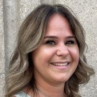 Portrait of Melissa Turzanski smiling.
